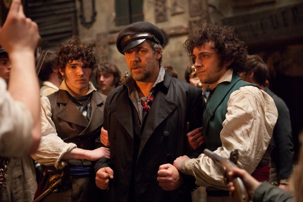 Javert in disguise is identified and held by the revolutionaries.